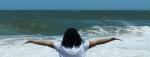 freedom woman on beach